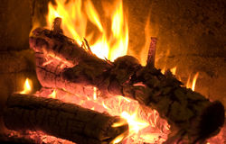 Fire. Place with two logs burning Royalty Free Stock Photo