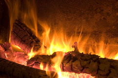 Fire. Place with two logs burning Royalty Free Stock Image