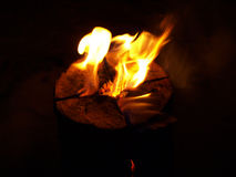 Fire. Original type of bonfire. Fire in the center of the log Stock Photo