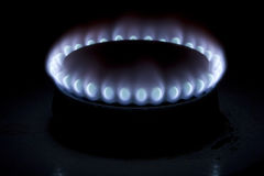Fire. On a cooker burning in the dark Royalty Free Stock Images