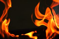 Fire. (Horizontal, Place for text in middle, black background Stock Photography