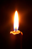 Fire. Burning candle on a black background Stock Images