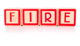 Fire!. Childrens bright red building blocks spelling the work fire Stock Photography