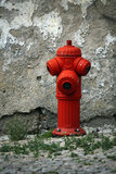 Fire. View of a red fire plug located on a street next to a decaying wall Royalty Free Stock Photos