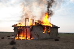 Fire in an abandoned house Stock Image