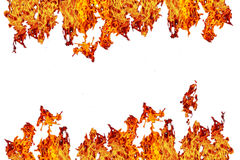 Fire or ablaze wall, yellow, orange and red and red Fire flame i. Solated on white isolated background Royalty Free Stock Images