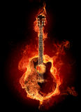 Fire acoustic guitar Stock Image