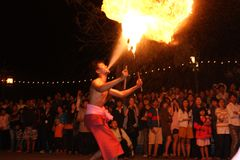 Fire acting in the night. Fire actor spraying in the night Stock Images