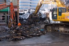 Fire Aftermath. Debris clean up in the aftermath of a six-alarm fire on Queen St. West on February 20, 2008 in Toronto- Canada, that destroyed 6 businesses in/ Stock Images