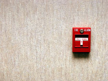 Fire Alarm. On wallpaper texture with room for text Royalty Free Stock Images