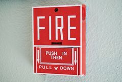 Fire Alarm. A fire alarm on a school wall Royalty Free Stock Image