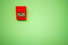 Fire alarm. This is fire alarm on the green background Stock Photos