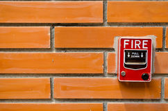 Fire alarm. On the old brick wall Stock Photography