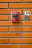 Fire alarm. On the old brick wall Royalty Free Stock Photo