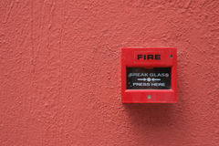 Fire alarm. Switch on red wall Stock Photo