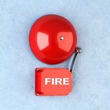 Fire alarm. 3d render of red retro fire alarm on blue wall Stock Images
