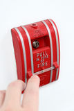 Fire alarm. Man hand pulling fire alarm Royalty Free Stock Photography