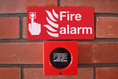 Fire alarm. Sign and alarm on brick wall Royalty Free Stock Image
