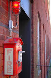 Fire Alarm Box. On factory wall Stock Photo