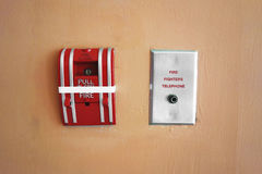 Fire alarm box on cement wall for warning and security system royalty free stock photography
