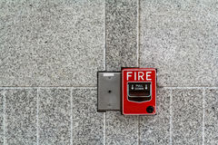 Fire alarm box on granite wall for warning Royalty Free Stock Image