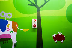 Fire alarm box mounted on colorful wall. In the kindergarden school stock image