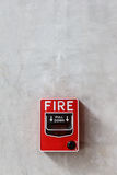 Fire alarm box on wall background Royalty Free Stock Photos