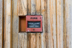 Fire alarm. Box on a wood wall Royalty Free Stock Photos