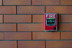 Fire alarm on brick wall black Royalty Free Stock Images