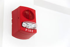 A fire alarm with built in strobe light. On white wall Stock Photo