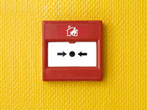 Fire Alarm Button. Break Glass Fire alarm button or box on a orange to brake in case of fire emergency Stock Images