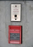 Fire alarm and fire fighter telephone on the wall Stock Photography