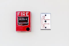 Fire Alarm and Firefighter's Phone Socket on white Concrete Wall Stock Photography