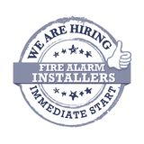 We are hiring Fire Alarm Installers - gray label for print. Fire Alarm Installers - We are hiring, immediate start - Job advertising / Job offer - Grunge label Royalty Free Stock Image