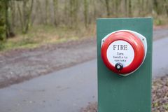 Fire alarm manual operation in countryside prevent and alert forest fire Stock Photos