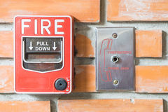 Fire Alarm with orange Wall stock image