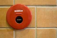 Fire alarm and phone jack on brick wall Royalty Free Stock Photos