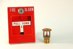 Fire alarm pull station. With a sprinkler head along side Stock Photo
