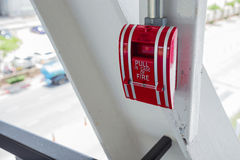 Fire alarm pull on the wall Royalty Free Stock Photos
