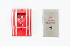 Fire alarm push botton. And fire fighters telephone on wall Stock Image