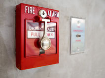 Fire Alarm. Push button switch, fire alarm on mortar wall for alarm and security system with fire extinguisher port stock image