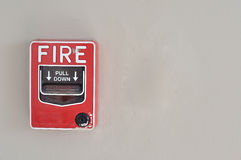 Fire alarm red box stick on wall Royalty Free Stock Photo