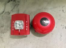 Fire Alarm red color on the marble wall. stock photography