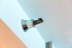 Fire alarm sprinkler on the wall. Chrome fire alarm sprinkler on the wall Stock Image