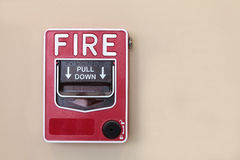 Fire alarm switch. On the wall royalty free stock image