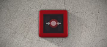 Composite image of fire alarm switch. Fire alarm switch against gray cracked concrete wall Royalty Free Stock Photo