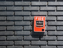 Fire alarm. Switch on black wall Stock Photo