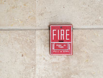 Fire alarm switch on brown wall Royalty Free Stock Photography