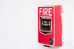 Fire alarm switch. On factory wall Royalty Free Stock Photos