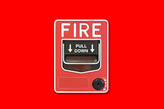 Fire alarm switch on the red wall. Royalty Free Stock Photography